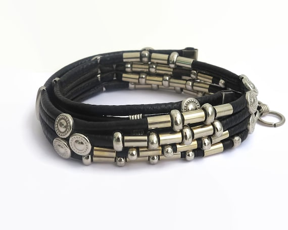 Vintage black leather belt with lots of silver tone metal features, 4 tubes of leather connected together, 28-32 inches / 71-81 cm, 1980s