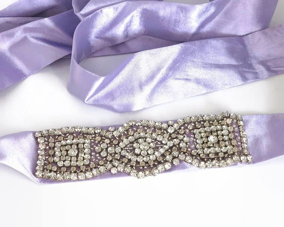 Large vintage rhinestone applique on purple sash, large circular rhinestones in prong settings, 6.5 x 2 inches / 16.5 x 5 cm, circa 1960s