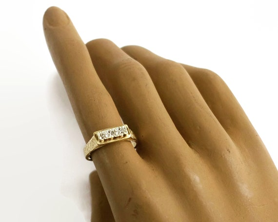 9 carat gold diamond ring, yellow and white gold, 3 small diamonds on elevated bar, textured metal, stackable, 1978, 2.5 gms, size 0.5 / 8.5
