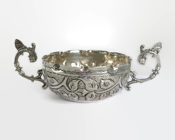 Small vintage silver plated bowl with embossed foliate pattern and fancy handles with butterflies, made in Italy