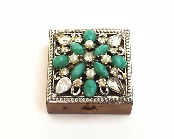 Jeweled pill box, Sam Fink and Co, rhinestones, faux pearls, green stones, mid 20th century