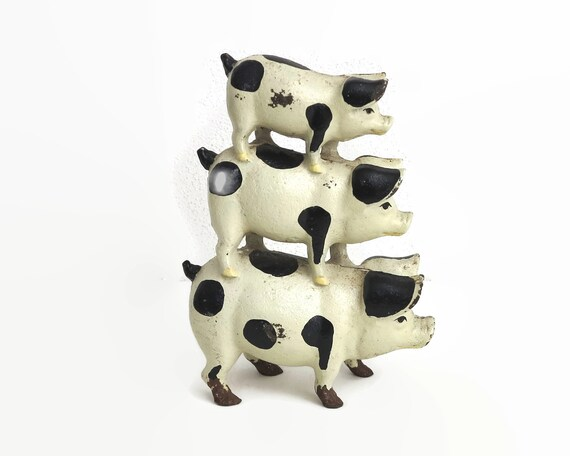Cast iron pig door stop, 3 spotted pigs on top of each other, white with black spots, heavy,