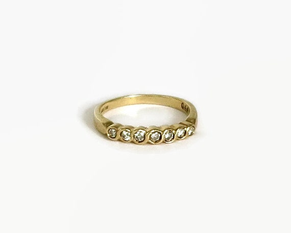 Diamond band ring in 9 carat yellow gold setting, 7 round diamonds, 30PTS, wedding band, anniversary ring, stackable ring