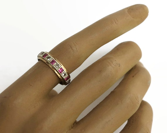 Diamond and ruby band ring with full circle of stones, 9 carat yellow and white gold setting, 11 diamonds, 11 rubies, 3 grams, size O / 7.25