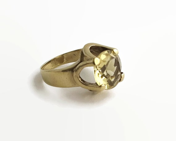 9 carat gold citrine ring with very large yellow citrine in elevated setting, 6 grams, size O / 7.5