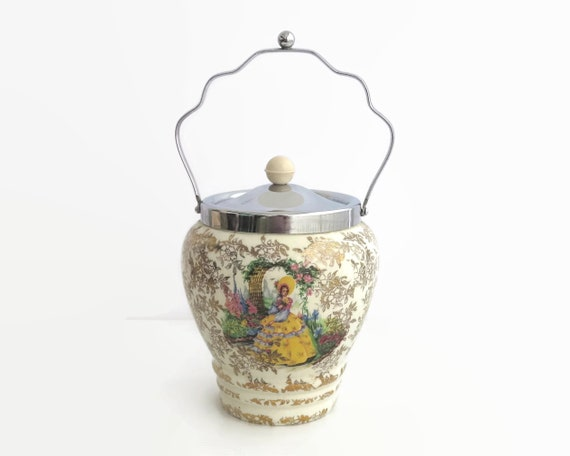 Vintage crinoline lady biscuit barrel with lots of gilt, silver plated lid and handle, made in England, transfer ware pattern, circa 1930s