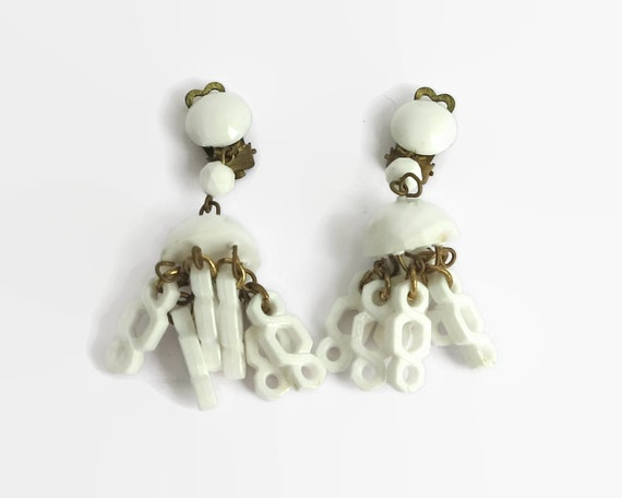 Vintage  chandelier earrings, white plastic with brass metal, infinity dangles, made in West Germany, clip ons, 1960s