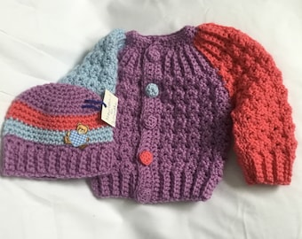 Hand crochet baby sweater with matching hat done in three colors in a size 3 to 6 months