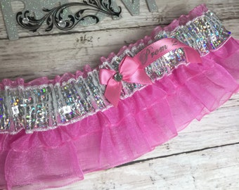 Prom garters. Black and pink prom garter with pink jewel