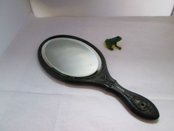 Antique Black Gutta Percha Oval Hand Mirror by Flo