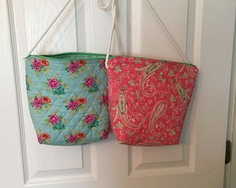 One aqua print purse and one pink print purse.