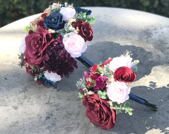 Shades of blue, red and blush paper and silk flower wedding bouquet