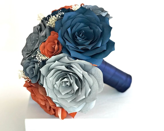 Bridal bouquet in burnt orange navy blue and shades of gray paper roses