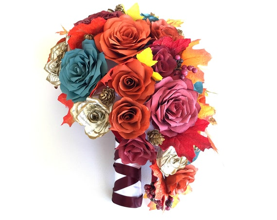 Fall themed teardrop bouquet in teal, burgundy, burnt orange and gold tipped book page flowers