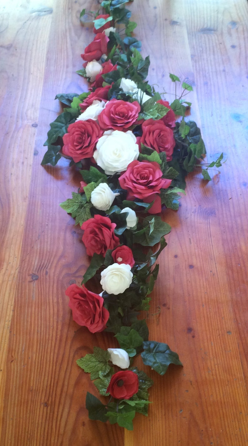 Red and white paper flower arch or table runner