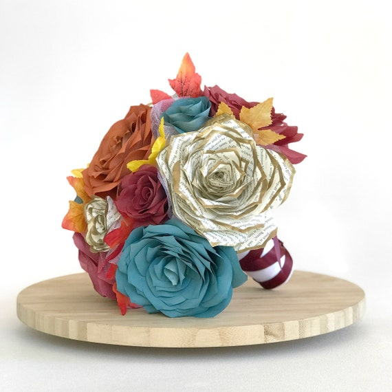 Fall themed bridal bouquet in teal, burgundy, burnt orange and book page flowers