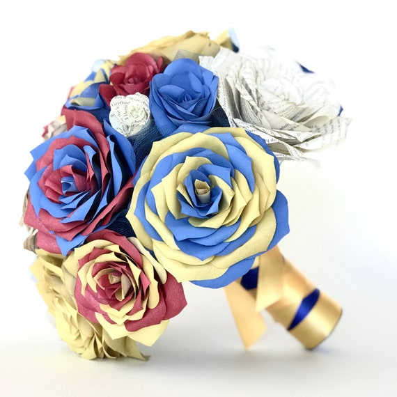 Bouquet shown in red, gold and blue paper flowers with book page roses- Customizable colors