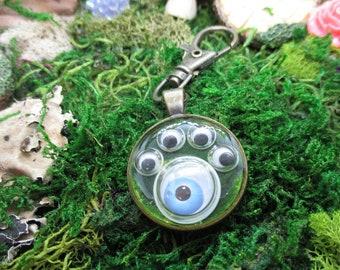 Resin skull keychain with googly eyes