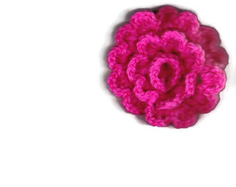 Pink crocheted applique flower