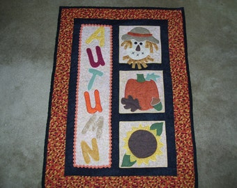 Fall quilt that has been machine quilted and appliqued-scarecrow quilt-pumpkin quilt-autumn quilt