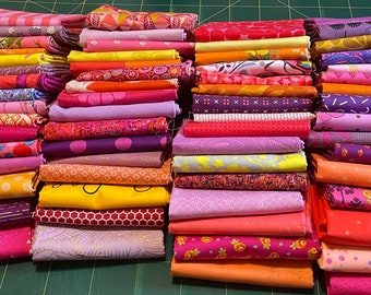 Fat 16th of various sunset inspired fabrics as shown in photo (64 in total)