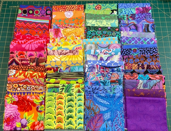 Fat 16th of various Kaffe Fassett Collective fabrics exactly as shown in photo (64in total)