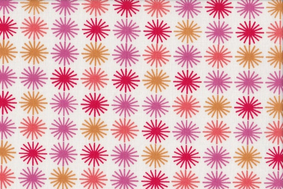 Japanese cotton fat quarter by Kei - Sunburst in pink and gold on white..