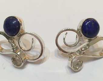Solid silver curl design stud earrings set with 8mm lapis Lazuli