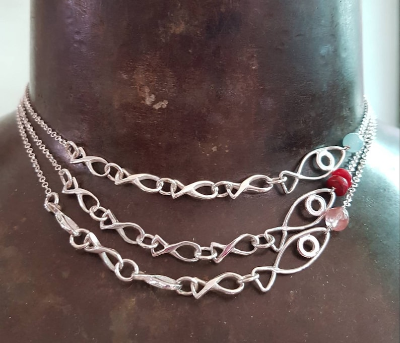 fish necklace in silver choker with family fish,