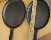 Vintage oval cast iron skillets pair of 2 new old stock black unbranded frying pans 9 quot long farm country cookware rustic farmhouse decor