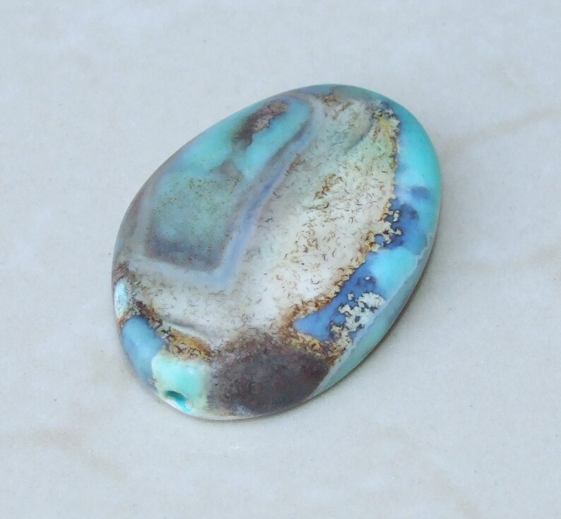 36mm Center Drilled Pale Blue Agate Twisted Oval Bead Pendant Polished Stone
