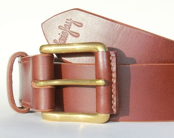 "Handstitched dark brown veg tan leather casual belt with solid brass buckle. Size large, to fit 36"" to 38"" waist. 1 1/2"" wide."