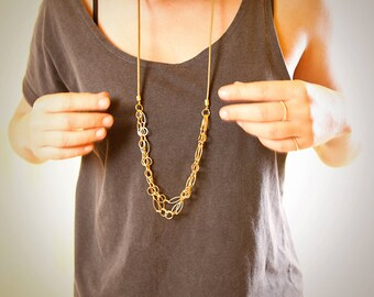 Long layering gold and green necklace, long statement necklace, long gold and leather trend  jewelry,  bib necklace