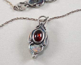 Tiny brilliant red garnet and Sterling Silver Necklace.  Ornate, arabesque pendant.  One of a kind.  Handmade.