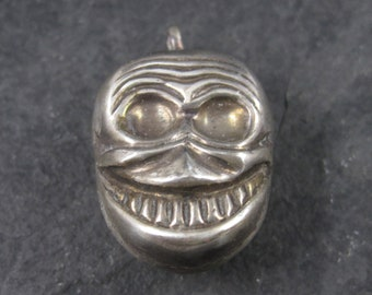 Vintage Sterling Creepy Smiling Skull Pedant