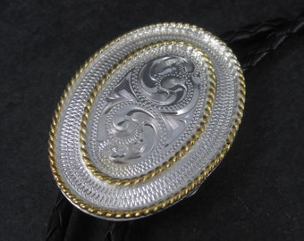 Vintage Western Silver Strike Leather Bolo Tie