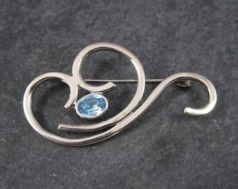 Vintage Sterling Blue Rhinestone Swirl Brooch
