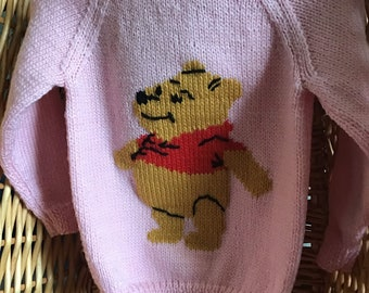 This pink sweater fits a 20 inch chest or a 9 month to 1 year old and has Winnie The Pooh embroidered on the front.