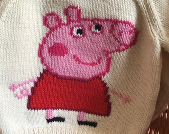 This cream sweater fits a 20 inch chest or a 9 month to 1 year old and has Peppa Pig embroidered on the front.