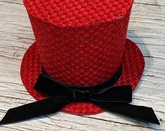 Red mini fabric tophat, snowman hat, wreath embellishment, skeleton hat