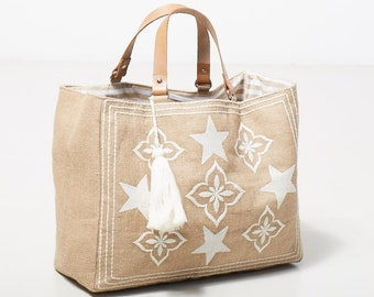 494557bc593e Beach bag  Embroidered hessian beach bags with leather handles and large  tassle charm