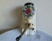 Decorative and colourful Wall hanging english Coffee grinder complete with lid and glass measure.