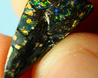 A small but very lovely piece of pipe boulder opal from the opalfields of Winton Queensland Australia