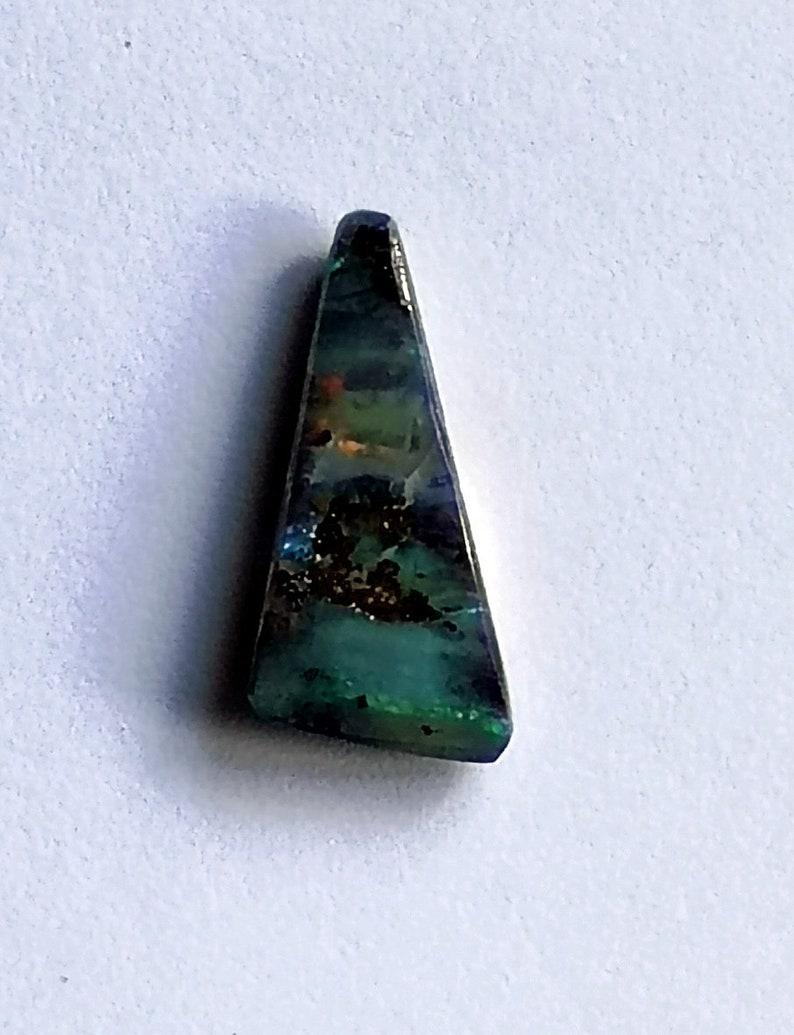 A small Winton boulder opal with an unusual triangular shape