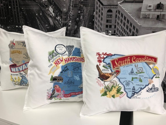 New Hampshire - Embroidered pillow with iconic landmarks and the state bird and flower