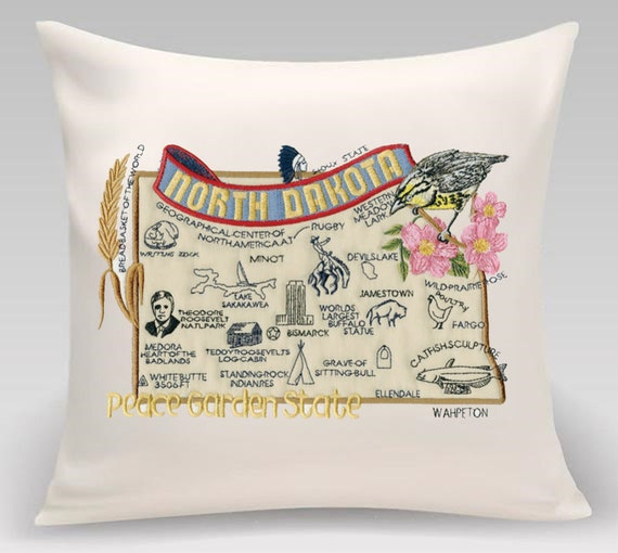 North Dakota - Embroidered pillow with iconic landmarks and the state bird and flower- Princeton Threads