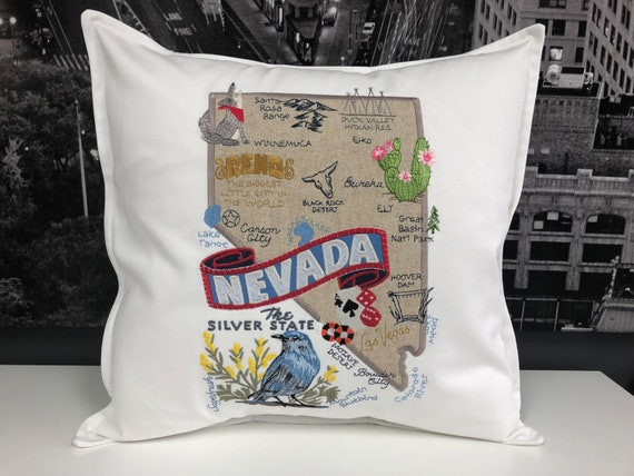Nevada - Embroidered state pillow featuring iconic landmarks with the state bird and flower
