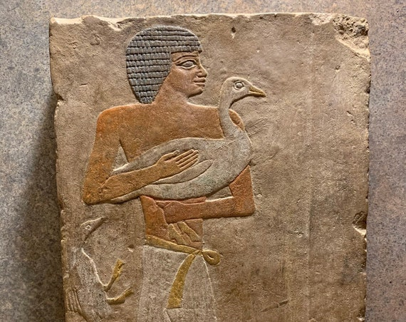 Egyptian relief 5th dynasty offering bearer