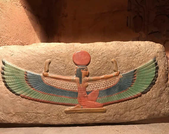 Egyptian art / wall relief sculpture of Maat the Goddess of truth, justice, balance and harmony. Egyptian mythology.