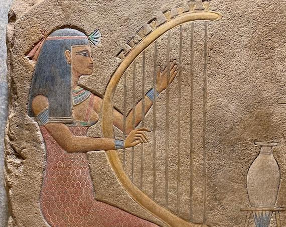 Egyptian art / relief sculpture - musicians - Harp & reed flute. Ancient Egypt